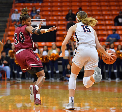 EL PASO, TEXAS - NOVEMBER 23, 2019:  Gia Pack #30 of the New Mexico State Aggies guards Avery Crouse #15 of the UTEP Miners during their game at the Don Haskins Center on November 23, 2019 in El Paso, Texas. The Miners defeated the Aggies 65-45.  (Photo by Sam Wasson/bleedCrimson.net)