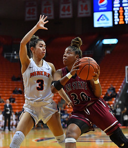 EL PASO, TEXAS - NOVEMBER 23, 2019:  Gia Pack #30 of the New Mexico State Aggies goes up for a shot against Katia Gallegos #3 of the UTEP Miners during their game at the Don Haskins Center on November 23, 2019 in El Paso, Texas.  (Photo by Sam Wasson/bleedCrimson.net)