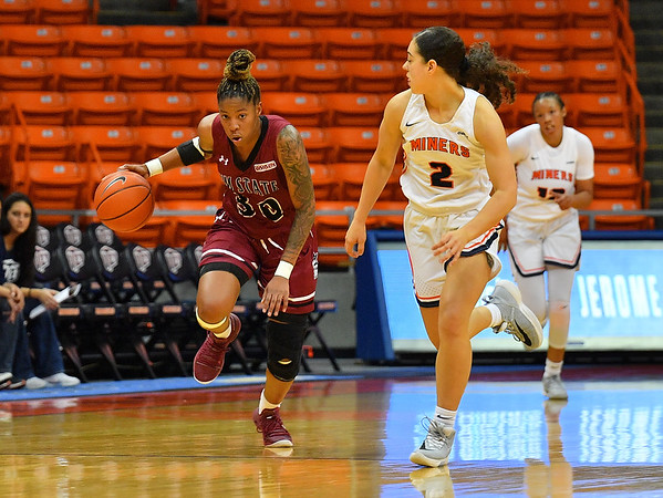 EL PASO, TEXAS - NOVEMBER 23, 2019:  Gia Pack #30 of the New Mexico State Aggies brings the ball up the court against Tia Bradshaw #2 of the UTEP Miners during their game at the Don Haskins Center on November 23, 2019 in El Paso, Texas. The Miners defeated the Aggies 65-45.  (Photo by Sam Wasson/bleedCrimson.net)
