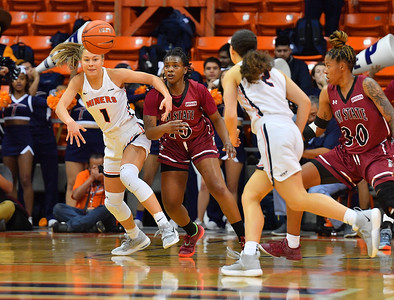 EL PASO, TEXAS - NOVEMBER 23, 2019:  Arina Khlopkova #1 of the UTEP Miners and Adrianna Henderson #10 of the New Mexico State Aggies scramble after a loose ball during their game at the Don Haskins Center on November 23, 2019 in El Paso, Texas. The Miners defeated the Aggies 65-45.  (Photo by Sam Wasson/bleedCrimson.net)