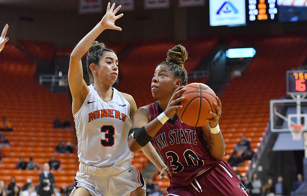 EL PASO, TEXAS - NOVEMBER 23, 2019:  Gia Pack #30 of the New Mexico State Aggies drives against Katia Gallegos #3 of the UTEP Miners during their game at the Don Haskins Center on November 23, 2019 in El Paso, Texas. The Miners defeated the Aggies 65-45.  (Photo by Sam Wasson/bleedCrimson.net)