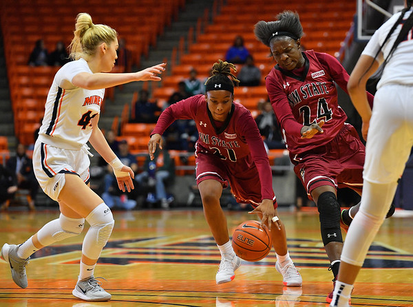 EL PASO, TEXAS - NOVEMBER 23, 2019:  Rodrea Echols #21 of the New Mexico State Aggies dribbles against Katarina Zec #44 of the UTEP Miners during their game at the Don Haskins Center on November 23, 2019 in El Paso, Texas. The Miners defeated the Aggies 65-45.  (Photo by Sam Wasson/bleedCrimson.net)