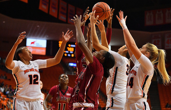 EL PASO, TEXAS - NOVEMBER 23, 2019:  Ariona Gill #12, Tatyana Modawar #31 and Katarina Zec #44 of the UTEP Miners battle Nana Sule #14 of the New Mexico State Aggies for a rebound during their game at the Don Haskins Center on November 23, 2019 in El Paso, Texas. The Miners defeated the Aggies 65-45.  (Photo by Sam Wasson/bleedCrimson.net)