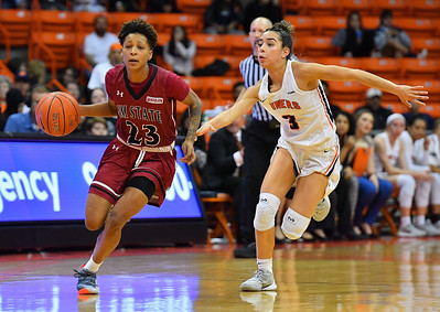 EL PASO, TEXAS - NOVEMBER 23, 2019:  Aaliyah Prince #23 of the New Mexico State Aggies drives against Katia Gallegos #3 of the UTEP Miners during their game at the Don Haskins Center on November 23, 2019 in El Paso, Texas. The Miners defeated the Aggies 65-45.  (Photo by Sam Wasson/bleedCrimson.net)
