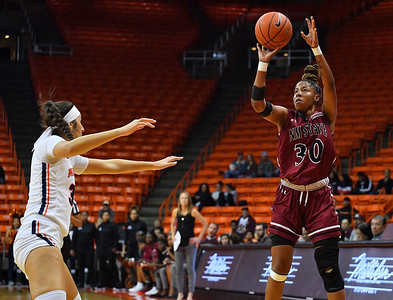 EL PASO, TEXAS - NOVEMBER 23, 2019:  Gia Pack #30 of the New Mexico State Aggies shoots against Tatyana Modawar #31 of the UTEP Miners during their game at the Don Haskins Center on November 23, 2019 in El Paso, Texas. The Miners defeated the Aggies 65-45.  (Photo by Sam Wasson/bleedCrimson.net)