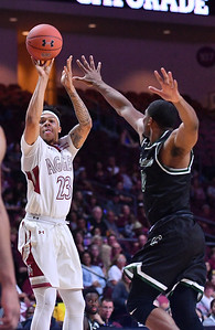 LAS VEGAS, NV - MARCH 08:  Zach Lofton #23 of the New Mexico State Aggies shoots against Glen Burns #0 of the Chicago State Cougars during a quarterfinal game of the Western Athletic Conference basketball tournament at the Orleans Arena in Las Vegas, Nevada. The Aggies won 97-70.
