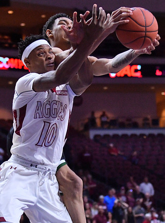 LAS VEGAS, NV - MARCH 08:  Jemerrio Jones #10 of the New Mexico State Aggies grabs a rebound against Cameron Bowles #21 of the Chicago State Cougars during a quarterfinal game of the Western Athletic Conference basketball tournament at the Orleans Arena in Las Vegas, Nevada. The Aggies won 97-70.