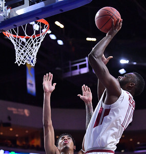 LAS VEGAS, NV - MARCH 08:  Johnathon Wilkins #11 of the New Mexico State Aggies shoots against Cameron Bowles #21 of the Chicago State Cougars during a quarterfinal game of the Western Athletic Conference basketball tournament at the Orleans Arena in Las Vegas, Nevada. The Aggies won 97-70.