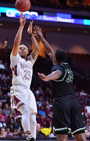 LAS VEGAS, NV - MARCH 08:  Zach Lofton #23 of the New Mexico State Aggies shoots against Montana Byrd #32 of the Chicago State Cougars during a quarterfinal game of the Western Athletic Conference basketball tournament at the Orleans Arena in Las Vegas, Nevada. The Aggies won 97-70.
