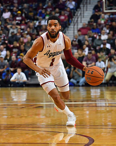 LAS CRUCES, NEW MEXICO - NOVEMBER 21, 2019:  Shunn Buchanan #1 of the New Mexico State Aggies dribbles against the New Mexico Lobos during their game at The Pan American Center on November 21, 2019 in Las Cruces, New Mexico. The Lobos defeated the Aggies 78-77.  (Photo by Sam Wasson/bleedCrimson.net)