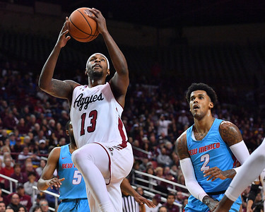 LAS CRUCES, NEW MEXICO - NOVEMBER 21, 2019:  C.J. Bobbitt #13 of the New Mexico State Aggies goes up for a shot against Vance Jackson #2 of the New Mexico Lobos during their game at The Pan American Center on November 21, 2019 in Las Cruces, New Mexico. The Lobos defeated the Aggies 78-77.  (Photo by Sam Wasson/bleedCrimson.net)