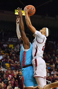 LAS CRUCES, NEW MEXICO - NOVEMBER 21, 2019:  Trevelin Queen #21 of the New Mexico State Aggies grabs a rebound against Zane Martin #0 of the New Mexico Lobos during their game at The Pan American Center on November 21, 2019 in Las Cruces, New Mexico. The Lobos defeated the Aggies 78-77.  (Photo by Sam Wasson/bleedCrimson.net)