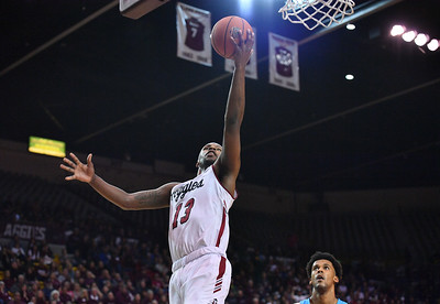 LAS CRUCES, NEW MEXICO - NOVEMBER 21, 2019:  C.J. Bobbitt #13 of the New Mexico State Aggies scores on a layup against the New Mexico Lobos during their game at The Pan American Center on November 20, 2019 in Las Cruces, New Mexico. The Lobos defeated the Aggies 78-77.  (Photo by Sam Wasson/bleedCrimson.net)