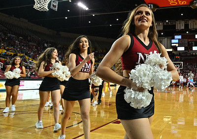 LAS CRUCES, NEW MEXICO - NOVEMBER 21, 2019:  Members of the New Mexico State Aggies dance team The Sundancers run off the court before the team's game against the New Mexico Lobos at The Pan American Center on November 21, 2019 in Las Cruces, New Mexico. The Lobos defeated the Aggies 78-77.  (Photo by Sam Wasson/bleedCrimson.net)