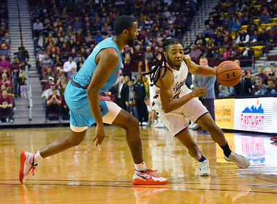 LAS CRUCES, NEW MEXICO - NOVEMBER 21, 2019:  Shawn Williams #55 of the New Mexico State Aggies drives against JaQuan Lyle #5 of the New Mexico Lobos during their game at The Pan American Center on November 21, 2019 in Las Cruces, New Mexico. The Lobos defeated the Aggies 78-77.  (Photo by Sam Wasson/bleedCrimson.net)