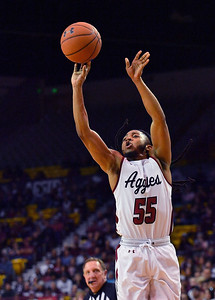 LAS CRUCES, NEW MEXICO - NOVEMBER 21, 2019:  Shawn Williams #55 of the New Mexico State Aggies shoots against the New Mexico Lobos during their game at The Pan American Center on November 21, 2019 in Las Cruces, New Mexico. The Lobos defeated the Aggies 78-77.  (Photo by Sam Wasson/bleedCrimson.net)
