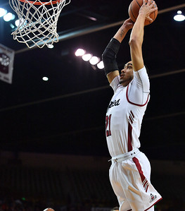 LAS CRUCES, NEW MEXICO - NOVEMBER 21, 2019:  Trevelin Queen #21 of the New Mexico State Aggies goes up for a dunk against the New Mexico Lobos during their game at The Pan American Center on November 21, 2019 in Las Cruces, New Mexico. The Lobos defeated the Aggies 78-77.  (Photo by Sam Wasson/bleedCrimson.net)