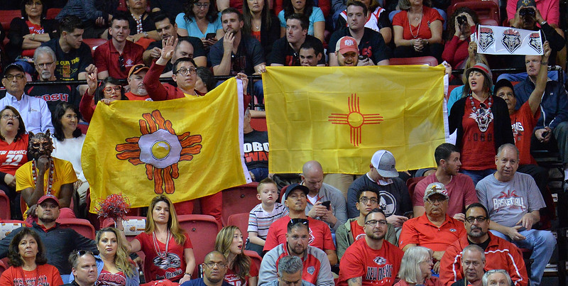 LAS VEGAS, NV - MARCH 10:  New Mexico Lobos fans cheer during the championship game of the Mountain West basketball tournament against the San Diego State Aztecs at the Thomas & Mack Center in Las Vegas, Nevada. San Diego State won 82-75.  (Photo by Sam Wasson)