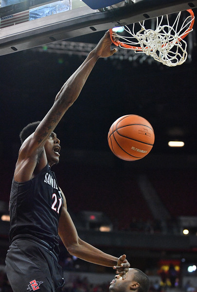 LAS VEGAS, NV - MARCH 10:  Malik Pope #21 of the San Diego State Aztecs dunks against the New Mexico Lobos during the championship game of the Mountain West basketball tournament at the Thomas & Mack Center in Las Vegas, Nevada. San Diego State won 82-75.  (Photo by Sam Wasson)
