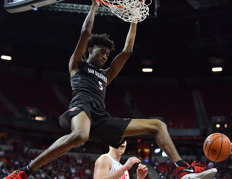LAS VEGAS, NV - MARCH 10:  Jalen McDaniels #5 of the San Diego State Aztecs dunks against the New Mexico Lobos during the championship game of the Mountain West basketball tournament at the Thomas & Mack Center in Las Vegas, Nevada. San Diego State won 82-75.  (Photo by Sam Wasson)