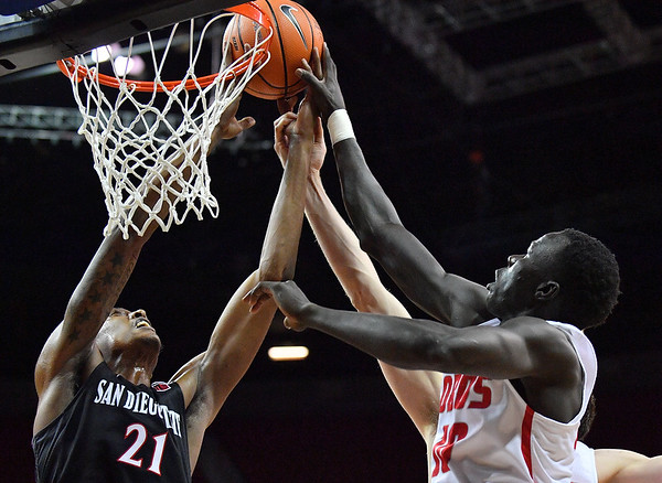 LAS VEGAS, NV - MARCH 10:  Malik Pope #21 of the San Diego State Aztecs and Makuach Maluach #10 of the New Mexico Lobos battle for a rebound during the championship game of the Mountain West basketball tournament at the Thomas & Mack Center in Las Vegas, Nevada. San Diego State won 82-75.  (Photo by Sam Wasson)