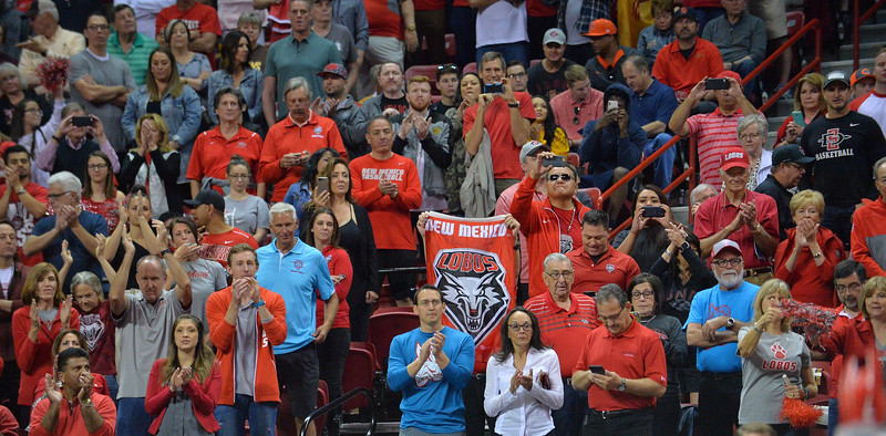 LAS VEGAS, NV - MARCH 10:  New Mexico Lobos fans cheer before the start of the championship game of the Mountain West basketball tournament between the New Mexico Lobos and the San Diego State Aztecs at the Thomas & Mack Center in Las Vegas, Nevada. San Diego State won 82-75.  (Photo by Sam Wasson)