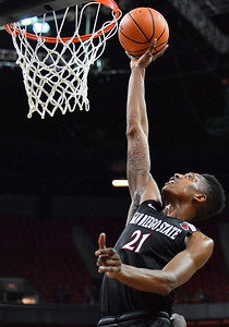 LAS VEGAS, NV - MARCH 10:  Malik Pope #21 of the San Diego State Aztecs gets a layup against the New Mexico Lobos during the championship game of the Mountain West basketball tournament at the Thomas & Mack Center in Las Vegas, Nevada. San Diego State won 82-75.  (Photo by Sam Wasson)