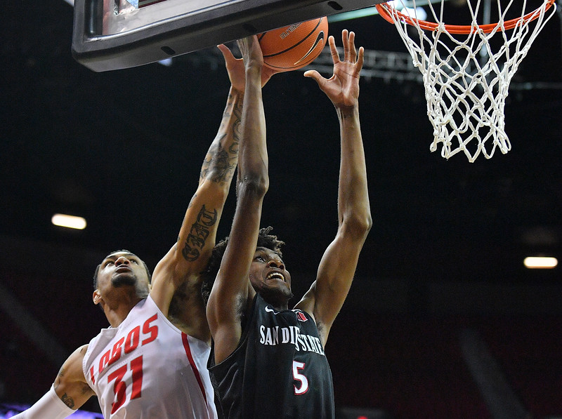 LAS VEGAS, NV - MARCH 10:  Anthony Mathis #32 of the New Mexico Lobos blocks a shot from Jalen McDaniels #5 of the San Diego State Aztecs during the championship game of the Mountain West basketball tournament at the Thomas & Mack Center in Las Vegas, Nevada. San Diego State won 82-75.  (Photo by Sam Wasson)
