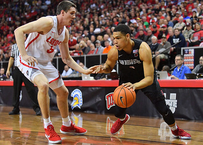 LAS VEGAS, NV - MARCH 10:  Trey Kell #3 of the San Diego State Aztecs drives against Joe Furstinger #5 of the New Mexico Lobos during the championship game of the Mountain West basketball tournament at the Thomas & Mack Center in Las Vegas, Nevada. San Diego State won 82-75.  (Photo by Sam Wasson)