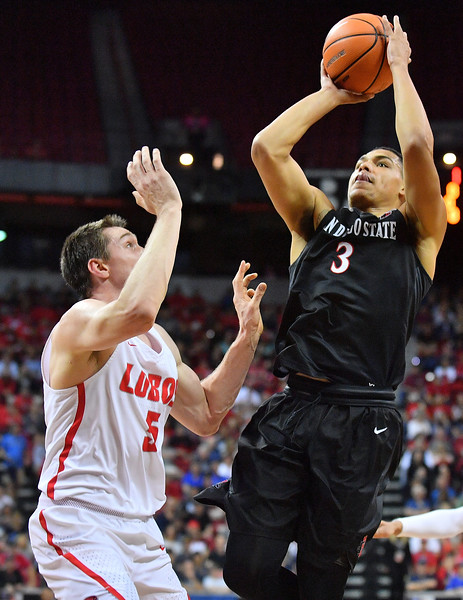 LAS VEGAS, NV - MARCH 10:  Trey Kell #3 of the San Diego State Aztecs shoots against Joe Furstinger #5 of the New Mexico Lobos during the championship game of the Mountain West basketball tournament at the Thomas & Mack Center in Las Vegas, Nevada. San Diego State won 82-75.  (Photo by Sam Wasson)