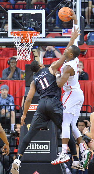 LAS VEGAS, NV - MARCH 10:  Antino Jackson #3 of the New Mexico Lobos attempts a dunk against Matt Mitchell #11 of the San Diego State Aztecs during the championship game of the Mountain West basketball tournament at the Thomas & Mack Center in Las Vegas, Nevada. San Diego State won 82-75.  (Photo by Sam Wasson)