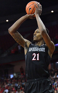 LAS VEGAS, NV - MARCH 10:  Malik Pope #21 of the San Diego State Aztecs shoots against the New Mexico Lobos during the championship game of the Mountain West basketball tournament at the Thomas & Mack Center in Las Vegas, Nevada. San Diego State won 82-75.  (Photo by Sam Wasson)