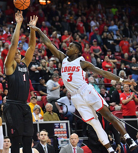 LAS VEGAS, NV - MARCH 10:  Max Montana #10 of the San Diego State Aztecs shoots against Antino Jackson #3 of the New Mexico Lobos during the championship game of the Mountain West basketball tournament at the Thomas & Mack Center in Las Vegas, Nevada. San Diego State won 82-75.  (Photo by Sam Wasson)