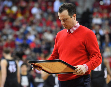 LAS VEGAS, NV - MARCH 10:  Head coach Paul Weir of the New Mexico Lobos draws up a play during a timeout during the championship game of the Mountain West basketball tournament against the San Diego State Aztecs at the Thomas & Mack Center in Las Vegas, Nevada. San Diego State won 82-75.  (Photo by Sam Wasson)