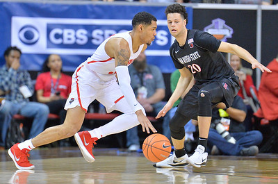 LAS VEGAS, NV - MARCH 10:  Antino Jackson #3 of the New Mexico Lobos drives against Jordan Schakel #20 of the San Diego State Aztecs during the championship game of the Mountain West basketball tournament at the Thomas & Mack Center in Las Vegas, Nevada. San Diego State won 82-75.  (Photo by Sam Wasson)