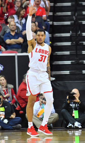 LAS VEGAS, NV - MARCH 10:  Troy Simons #31 of the New Mexico Lobos reacts after hitting a three-point shot against the San Diego State Aztecs during the championship game of the Mountain West basketball tournament at the Thomas & Mack Center in Las Vegas, Nevada. San Diego State won 82-75.  (Photo by Sam Wasson)