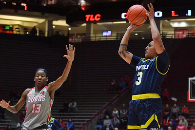 ALBUQUERQUE, NEW MEXICO - NOVEMBER 08, 2019:  Lauren Orndoff #20 of the Northern Arizona Lumberjacks shoots against Shaiquel McGruder #13 of the New Mexico Lobos during their game at Dreamstyle Arena - The Pit on November 08, 2019 in Albuquerque, New Mexico.  (Photo by Sam Wasson for NAU Athletics)