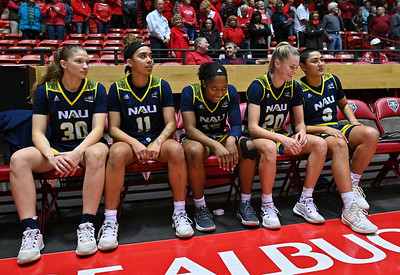 ALBUQUERQUE, NEW MEXICO - NOVEMBER 08, 2019:  Nina Radford #30, Jacey Bailey #11, Khiarica Rasheed #15, Lauren Orndoff #20 and Caitlin Malvar #3 of the Northern Arizona Lumberjacks sit on the bench before their game against the New Mexico Lobos at Dreamstyle Arena - The Pit on November 08, 2019 in Albuquerque, New Mexico.  (Photo by Sam Wasson for NAU Athletics)
