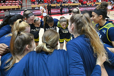 ALBUQUERQUE, NEW MEXICO - NOVEMBER 08, 2019:  The Northern Arizona Lumberjacks huddle before tip-off of their game against the New Mexico Lobos at Dreamstyle Arena - The Pit on November 08, 2019 in Albuquerque, New Mexico.  (Photo by Sam Wasson for NAU Athletics)