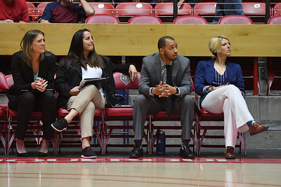 ALBUQUERQUE, NEW MEXICO - NOVEMBER 08, 2019:  (L-R) Assistant coaches Jenny Thigpen, Kellee Barney, Brandon Huntley and head coach Loree Payne of the Northern Arizona Lumberjacks look on during warmups before their team's game against the New Mexico Lobos at Dreamstyle Arena - The Pit on November 08, 2019 in Albuquerque, New Mexico.  (Photo by Sam Wasson for NAU Athletics)