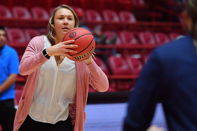 ALBUQUERQUE, NEW MEXICO - NOVEMBER 08, 2019:  Graduate assistant Meghan Hamel of the Northern Arizona Lumberjacks passes a ball before her team's game against the New Mexico Lobos at Dreamstyle Arena - The Pit on November 08, 2019 in Albuquerque, New Mexico.  (Photo by Sam Wasson for NAU Athletics)