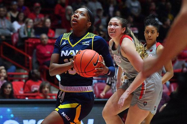 ALBUQUERQUE, NEW MEXICO - NOVEMBER 08, 2019:  Khiarica Rasheed #15 of the Northern Arizona Lumberjacks drives to the basket against the New Mexico Lobos during their game at Dreamstyle Arena - The Pit on November 08, 2019 in Albuquerque, New Mexico.  (Photo by Sam Wasson for NAU Athletics)