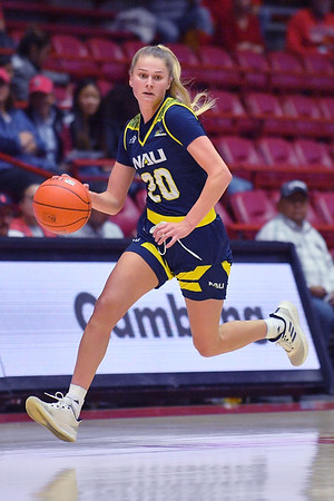 ALBUQUERQUE, NEW MEXICO - NOVEMBER 08, 2019:  Lauren Orndoff #20 of the Northern Arizona Lumberjacks brings the ball up the court against the New Mexico Lobos during their game at Dreamstyle Arena - The Pit on November 08, 2019 in Albuquerque, New Mexico.  (Photo by Sam Wasson for NAU Athletics)