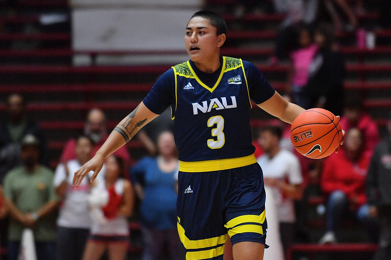 ALBUQUERQUE, NEW MEXICO - NOVEMBER 08, 2019:  Caitlin Malvar #3 of the Northern Arizona Lumberjacks brings the ball up the court against the New Mexico Lobosduring their game at Dreamstyle Arena - The Pit on November 08, 2019 in Albuquerque, New Mexico.  (Photo by Sam Wasson for NAU Athletics)