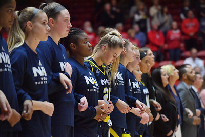ALBUQUERQUE, NEW MEXICO - NOVEMBER 08, 2019:  The Northern Arizona Lumberjacks stand on the court during the playing of the American national anthem before their game against the New Mexico Lobos at Dreamstyle Arena - The Pit on November 08, 2019 in Albuquerque, New Mexico.  (Photo by Sam Wasson for NAU Athletics)