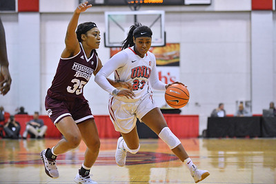 Dec 20, 2017; Las Vegas, NV, USA;  UNLV Rebels forward Jordyn Bell (23) drives against Mississippi State Bulldogs guard Victoria Vivians (35) during the Duel In The Desert at the Cox Pavilion in Las Vegas, Nevada.  Photo by Sam Wasson for UNLV Athletics