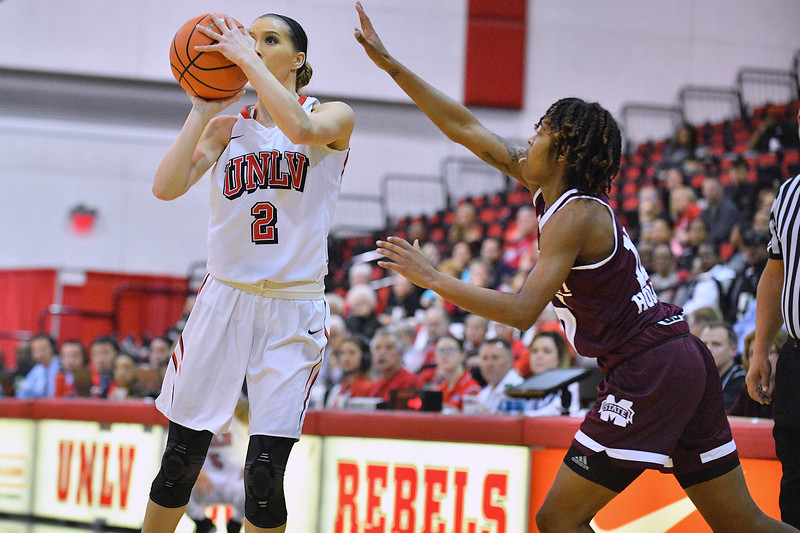 Dec 20, 2017; Las Vegas, NV, USA;  UNLV Rebels guard Brooke Johnson (2) shoots against Mississippi State Bulldogs guard Jazzmun Holmes (10) during the Duel In The Desert at the Cox Pavilion in Las Vegas, Nevada.  Photo by Sam Wasson for UNLV Athletics