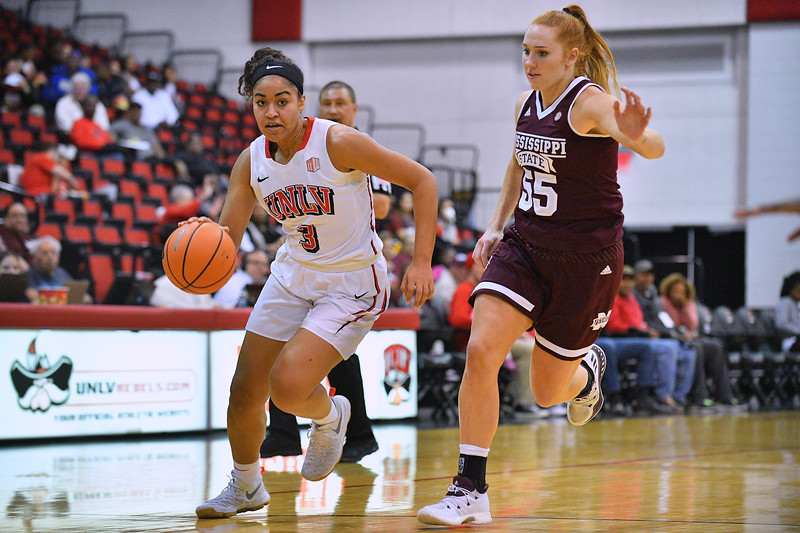 Dec 20, 2017; Las Vegas, NV, USA;  UNLV Rebels forward/center Paris Strawther (3) drives against Mississippi State Bulldogs forward Chloe Bibby (55) during the Duel In The Desert at the Cox Pavilion in Las Vegas, Nevada.  Photo by Sam Wasson for UNLV Athletics