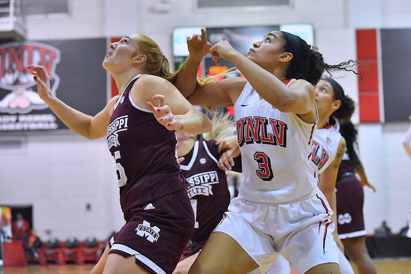 Dec 20, 2017; Las Vegas, NV, USA;  UNLV Rebels forward/center Paris Strawther (3) gets in position for a rebound against Mississippi State Bulldogs forward Chloe Bibby (55) during the Duel In The Desert at the Cox Pavilion in Las Vegas, Nevada.  Photo by Sam Wasson for UNLV Athletics
