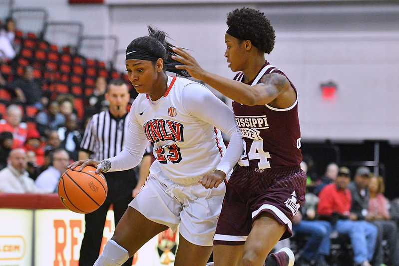 Dec 20, 2017; Las Vegas, NV, USA;  UNLV Rebels forward Jordyn Bell (23) drives against Mississippi State Bulldogs guard Jordan Danberry (24) during the Duel In The Desert at the Cox Pavilion in Las Vegas, Nevada.  Photo by Sam Wasson for UNLV Athletics